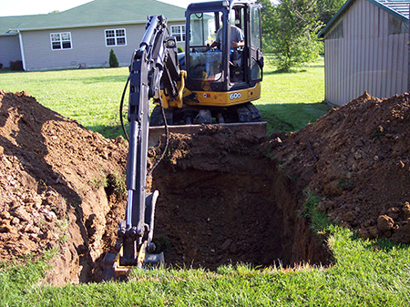 digging hole for storm shelter